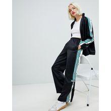 adidas Originals - Schwarze Hose mit drei Streifen, Druckkknöpfen und Vintage-Logo - Schwarz