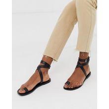 ASOS DESIGN - Finer - Minimalistische, flache Sandalen aus Leder mit Zehenschlaufe - Schwarz
