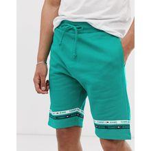 Tommy Jeans - Grüne Trainingsshorts mit Zierstreifen am Bein - Grün