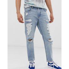 ASOS DESIGN - Klassische feste Jeans in heller Vintage-Waschung mit großen Rissen - Blau