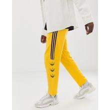 adidas Originals - DV3149 - Jogginghose in Gelb mit Dreiblatt und Streifen - Gelb