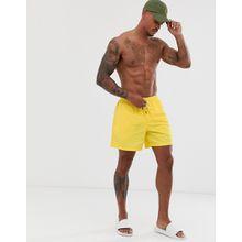 Polo Ralph Lauren - Traveler - Schmal geschnittene Badeshorts mit Polospieler-Logo in Gelb - Gelb