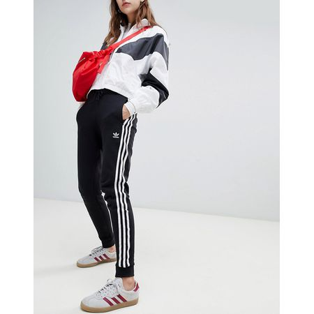Adidas Originals - Trainingshose mit drei Streifen und Bündchen in Schwarz  - Schwarz 8d5258fbf6